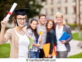 happy teenage students with diploma and folders - education,...