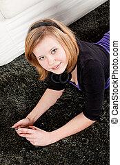 happy teenager girl listening to music