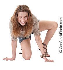 Happy teenager girl sitting on the floor