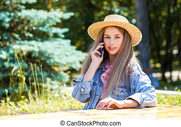 Happy teenager girl with a mobile phone