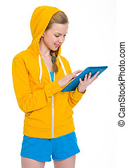Happy teenager girl working on tablet pc