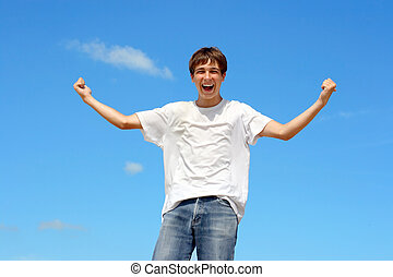 happy teenager on blue sky background