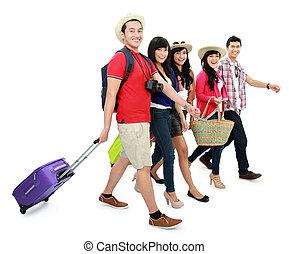 happy teenager tourists