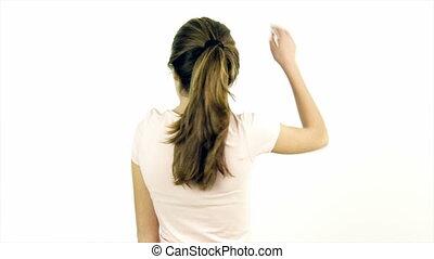 Happy teenager undoing ponytail