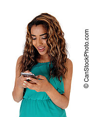 Happy teenager whit a good message on her phone