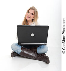 Happy teenager with laptop