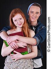 Happy teenagers couple hugging