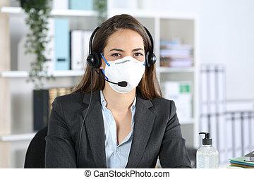Happy telemarketer posing avoiding covid-19 at office
