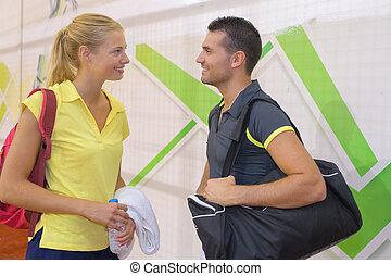 happy tennis couple