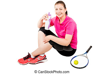 Happy tennis player after training with water bottle sitting on a white background in studio