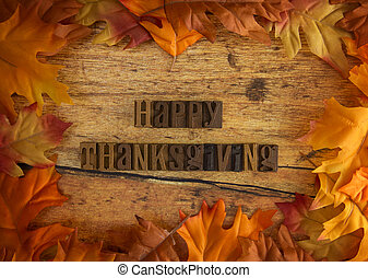 Happy Thanksgiving Background with Bright Orange and Red Autumn Leaves