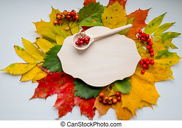 Happy Thanksgiving Card. Autumn Background. Autumn harvest still life with rowanberry, top view. Autumn still life concept background. Fall leaves, harvest, ashberry on table top. Thanksgiving postcard