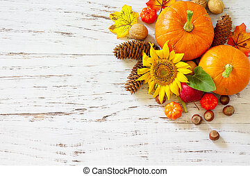 Happy Thanksgiving concept. Pumpkins, sunflowers, apples and fallen leaves on rustic wooden table. Top view flat lay. Copy space.