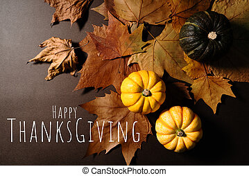 Happy Thanksgiving Day with pumpkin and maple leaves