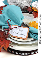 Happy Thanksgiving dining table place setting in Autumn brown and aqua color theme - closeup.