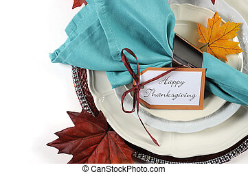 Happy Thanksgiving dining table place setting in Autumn brown and aqua color theme with copy space.