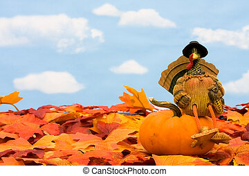 Fall leaves with a turkey and a gourd on a sky background, fall border