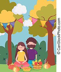 happy thanksgiving family, couple sitting in the park with food