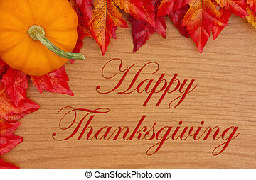 Happy Thanksgiving greeting with red and orange fall leaves and a pumpkin