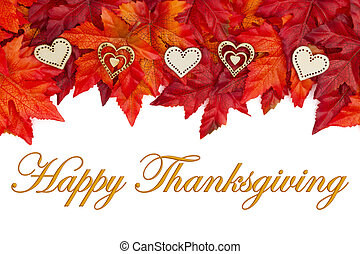 Happy Thanksgiving greeting with red and orange fall leaves and wood hearts