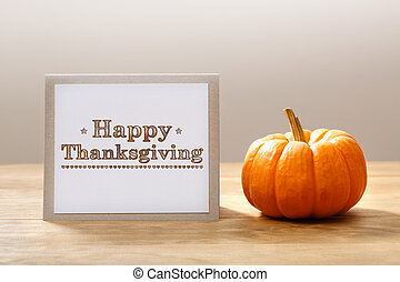 Happy Thanksgiving message with a small pumpkin