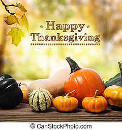 Happy Thanksgiving message with assorted pumpkins