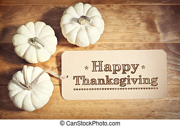 Happy Thanksgiving message with small white pumpkins on ...