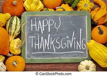 Happy Thanksgiving on blackboard with squash
