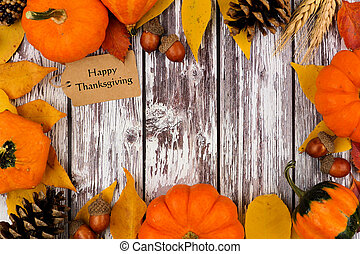 Happy Thanksgiving tag with autumn frame on old white wood