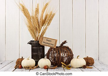 Happy Thanksgiving tag with decor against white wood