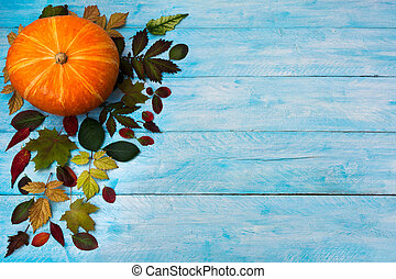 Happy Thanksgiving with fall leaves on blue background