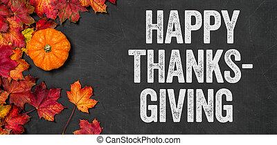 Happy thanksgiving written on a blackboard