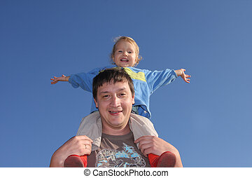 Happy the daddy with a daughter against the sky 2