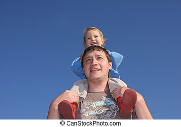 Happy the daddy with a daughter against the sky 4