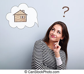 Happy thinking casual woman in looking up on illustration house in bubble cloud above the head. Insurance protection concept, investment to safety money.