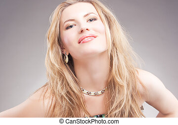 happy time - smiling caucasian blonde woman with necklace...