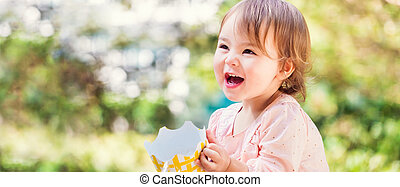 Happy toddler girl close up panorama outside