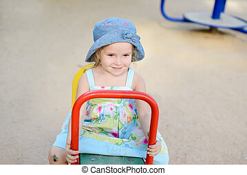 toddler girl on the playground