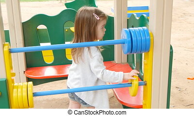 Happy toddler girl on the playground