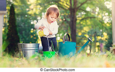 Happy toddler girl playing outside