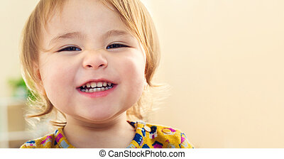 Happy toddler girl with a big beautiful smile