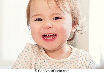 Happy toddler girl with a big smile