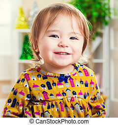 Happy toddler girl with a nice smile