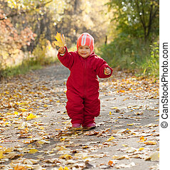 Happy toddler  in autumn