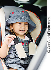 happy toddler in the car