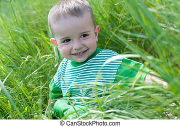 Happy toddler in the field