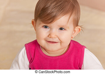 Happy toddler is always smiling - Closeup portrait of a ...
