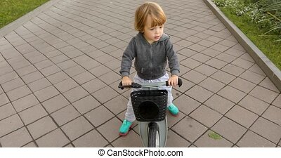 Happy toddler riding bicycle - Smiling casual boy riding...
