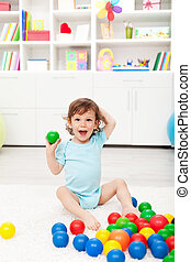 Happy toddler with balls