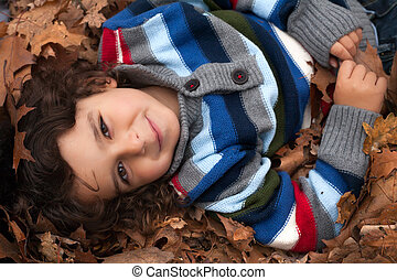 happy toddler with leafs - Happy foster children in the...